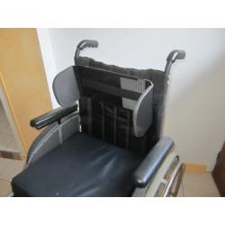 Cale-tronc pour fauteuil roulant de personne handicapée