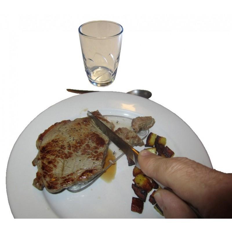Planchette à picots avec ventouse pour maintenir la viande dans l'assiette pendant qu'on la coupe d'une seule main